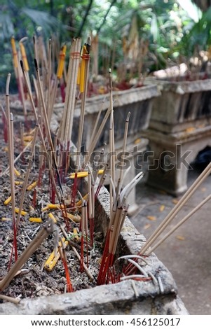 Incense candle in the pot to worship. - stock photo