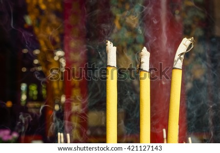 Incense furnace with smoking joss stick with place your text - stock photo