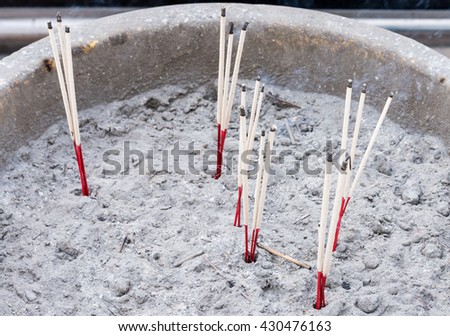 Incense stick bundle is burned for worship in the Thai temple. - stock photo