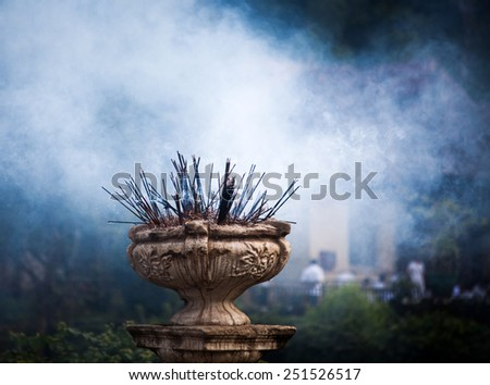 Incense sticks burning in front of Temple of the Tooth, Kandy, Sri Lanka - stock photo