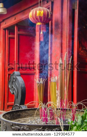Incenses burning in front of Buddhist temple in Ho Chi minh Complex, Hanoi, Vietnam - stock photo