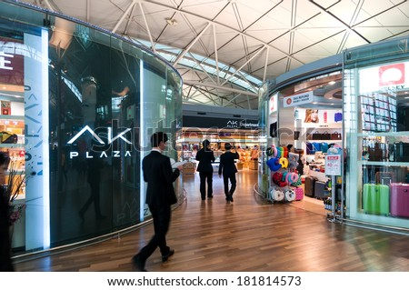 INCHEON, SOUTH KOREA - JANUARY 30: Travelers pass through the duty free shops in Incheon Airport on January 30, 2014 in Incheon, South Korea. - stock photo