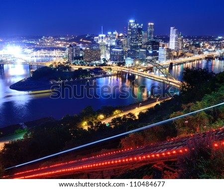 Incline operating in front of the downtown skyline of Pittsburgh, Pennsylvania, USA. - stock photo