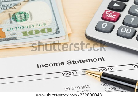 Income statement financial report with pen and calculator - stock photo
