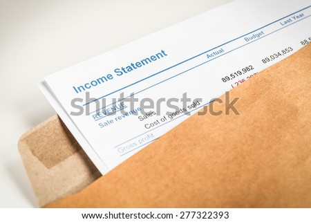 Income statement letter in brown envelope opening, business concept; document is mock-up - stock photo