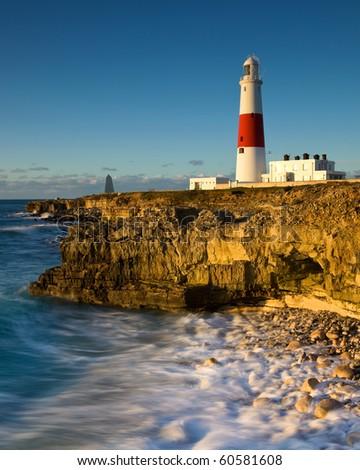 Incoming tide at Portland Bill lighthouse, Dorset, UK. Part of the UNESCO world heritage jurassic coast - stock photo