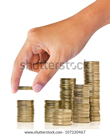 Increase your savings-Hand holding coins against white background - stock photo
