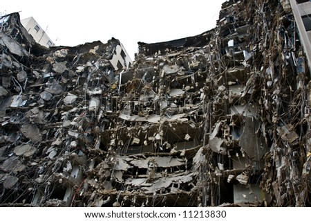 incredible demolition project - wrecked building shell on white - part of series - stock photo