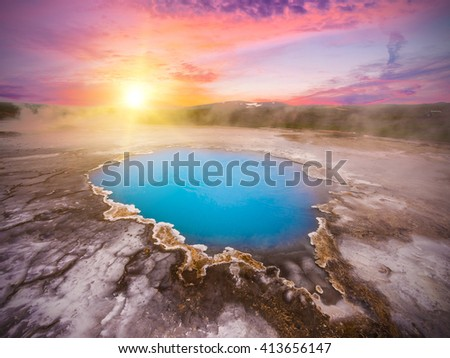 Incredibly blue pool Blahver at Hveravellir is actually a hot geothermal spring in the heart of Iceland. Photo taken around midnight sunset - stock photo