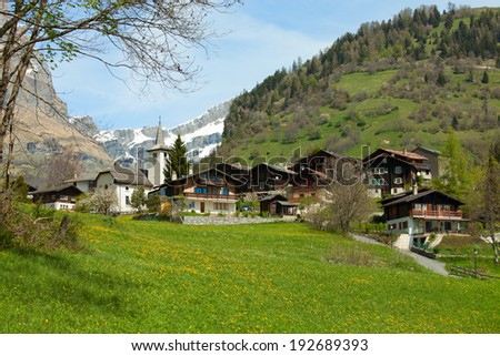 Inden church and surrounding village, Canton of Valais, Switzerland - stock photo