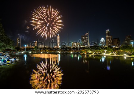 Independence Day fireworks in Austin, Texas, USA at Auditorium Shores. - stock photo