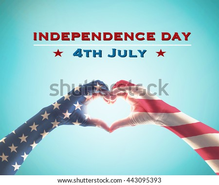 Independence day 4th of July concept: America flag pattern on happy people hands in heart shaped form isolated on blue sky background: United states of america USA labor day, US veterans day concept - stock photo