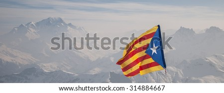 Independence flag of Catalonia waving in front of Mont Blanc massif. Alps, France. - stock photo