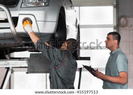 Independent car inspection at factory. Auto building plant, new model testing. Automobile production concept - stock photo