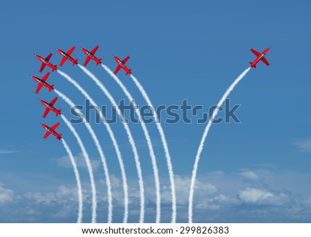 Independent innovation and new thinking concept or individuality leadership symbol as a group of flying jet airplanes with one individual aircraft going in the opposite direction as a business icon. - stock photo