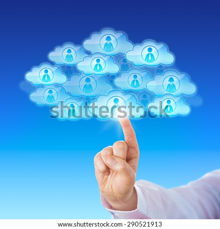Index finger of a white collar worker is touching a cloud icon to connect with many peers in cyberspace. Numerous cloud icons with worker symbols do combine to form a single larger cloud shape. - stock photo