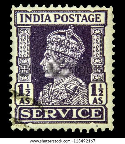 "INDIA - CIRCA 1942: A stamp printed in India shows King George VI, without inscription, from the series ""King George VI"", circa 1942 - stock photo"