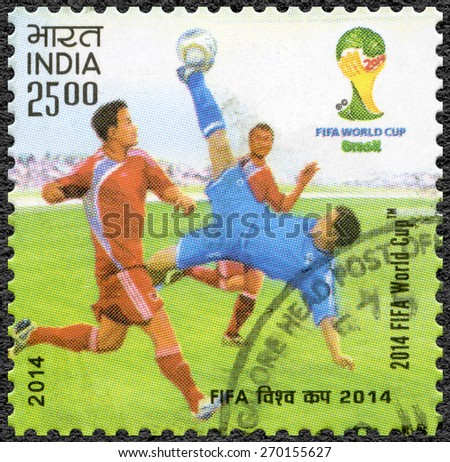 INDIA - CIRCA 2014: A stamp printed in India shows soccer players, dedicated the 2014 FIFA World Cup Brazil, June 12 - July 13, circa 2014 - stock photo