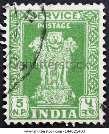"INDIA - CIRCA 1967: An Indian stamp shows four lions without inscription, from the series ""Ashoka Pillar"", circa 1967 - stock photo"
