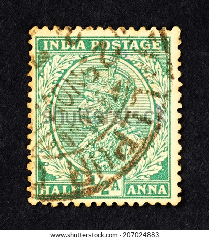 INDIA - CIRCA 1911: Green color postage stamp printed in British India with portrait image of a King George V. - stock photo