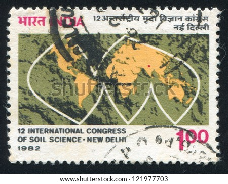INDIA - CIRCA 1982: stamp printed by India, shows stylized map with continents, circa 1982 - stock photo