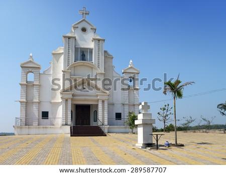 India. Goa. Catholic church at hill top - stock photo
