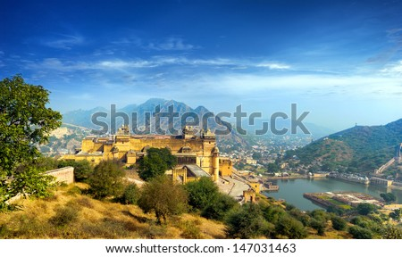 India Jaipur Amber fort in Rajasthan. Ancient indian palace architecture sunset panoramic view - stock photo