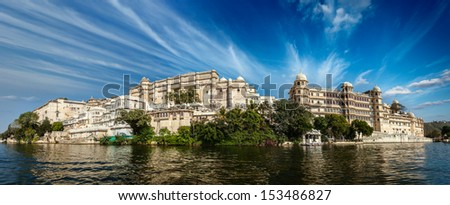 India luxury tourism concept background - panorama of Udaipur City Palace from Lake Pichola. Udaipur, India - stock photo
