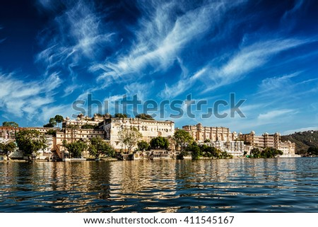 India luxury tourism concept background - Udaipur City Palace view from Lake Pichola. Udaipur, Rajasthan, India - stock photo