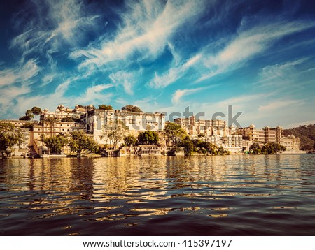 India luxury tourism concept background - vintage retro effect filtered hipster style image of Udaipur City Palace view from Lake Pichola. Udaipur, Rajasthan, India - stock photo