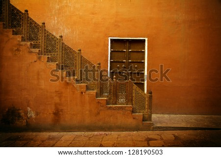 India, orange interior of a local house, stairs - stock photo