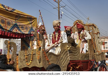 INDIA, Rajasthan, Jaipur; 25 january 2007, indian grooms, dressed with local money bills, going to their wedding on the bridal carriage - EDITORIAL - stock photo
