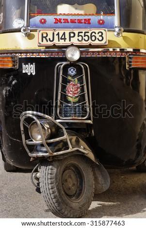 India, Rajasthan, Jaipur; 26 january 2007, local Tuk Tuk taxi motorbike - stock photo