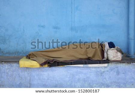 India, Rajasthan, Pushkar, street bum sleeping - stock photo