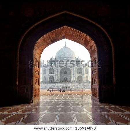 India. Taj Mahal indian palace in Agra. Tajmahal arch view - stock photo