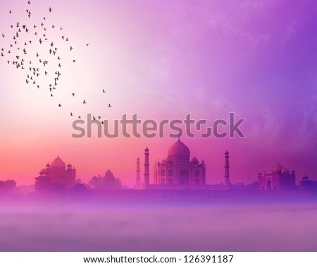 India. Taj Mahal sunset silhouette. Tajmahal palace in sunset sky - stock photo