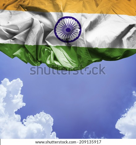 India waving flag on a beautiful day - stock photo