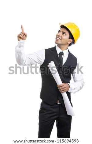 Indian Architect holding blueprints - stock photo