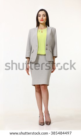 indian asian eastern brunette business executive woman with straight hair style in jacket and  skirt suit high heels shoes full length body portrait standing isolated on white - stock photo