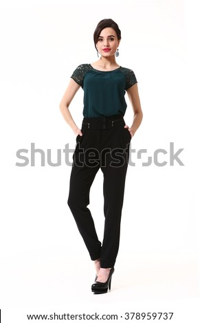 indian asian eastern brunette business executive woman with straight hair style in official black trousers and green t-shirt high heels shoes stand full body length isolated on white - stock photo
