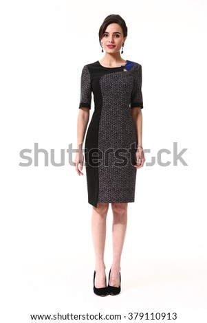 indian asian eastern brunette business executive woman with up do hair style in official short sleeve dark dress suit high heels shoes stand full body length isolated on white - stock photo