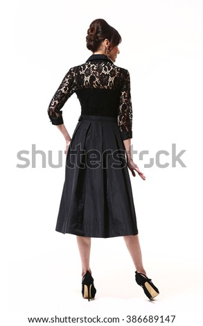indian asian eastern brunette business executive woman with updo hair style in lace formal black  dress high heel shoes standing full body length isolated on white back view - stock photo