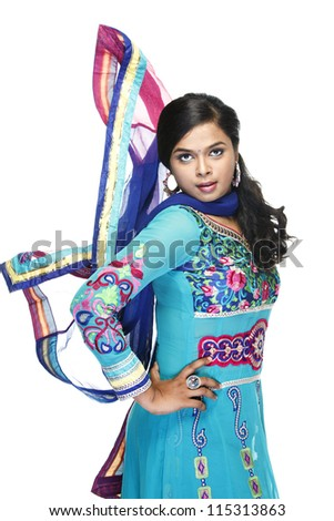 Indian Beautiful girl wearied Indian traditional churidar on white background. - stock photo