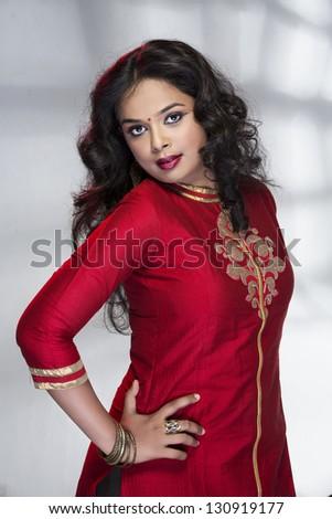 Indian Beautiful girl wearied Indian traditional red churidar. - stock photo