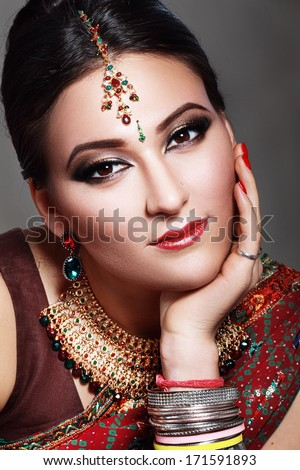 Indian beauty face close up, perfect make up. Series. young beautiful brunette in traditional national dress  - stock photo