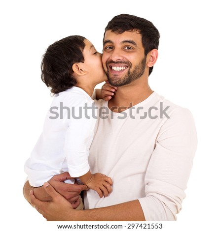 indian boy kissing his dad isolated on white background - stock photo