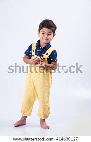 indian boy standing over white background, asian little boy standing isolated over white background, indian boy model - stock photo