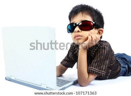 Indian boy using a laptop with 3d Glasses - stock photo