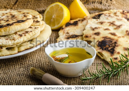 Indian bread with rosemary, garlic and olive oil - stock photo