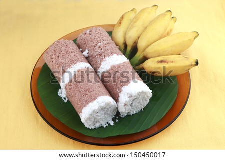 Indian breakfast Puttu with a bunch of banana. - stock photo